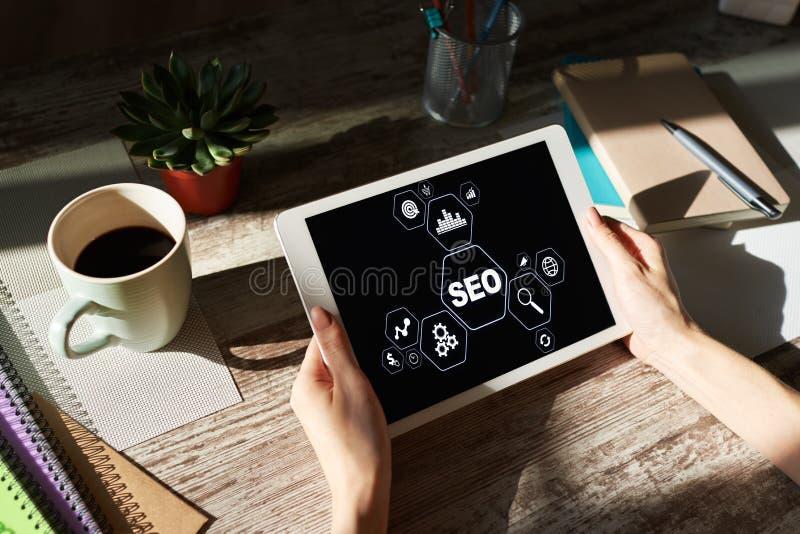 SEO - Search engine optimization. DIgital marketing concept on screen. SEO - Search engine optimization. DIgital marketing concept on screen stock images