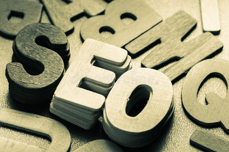 SEO. (search engine optimization) in stack of wood letters royalty free stock photos