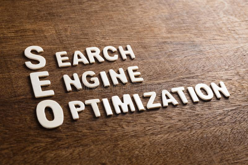 SEO Wood Letters. SEO Search Engine Optimization text by wood letters on wood texture royalty free stock photo