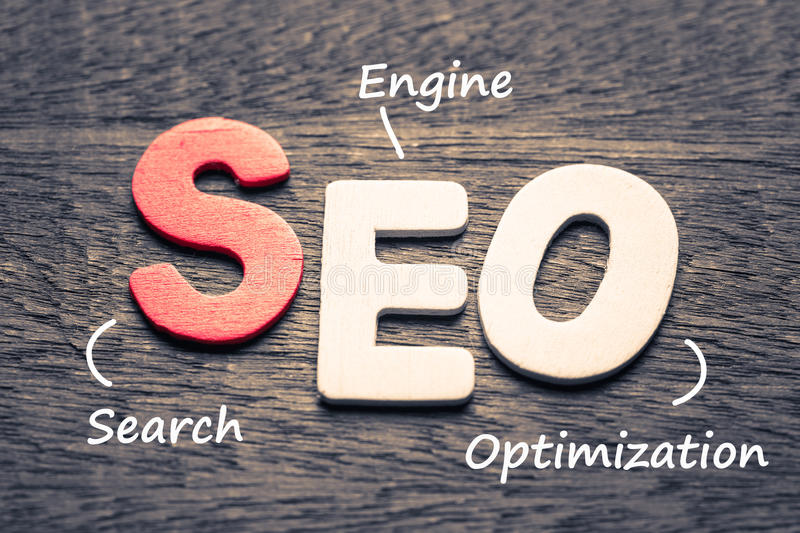 SEO Search Engine Optimization. Wood letters of SEO and definition on wood background