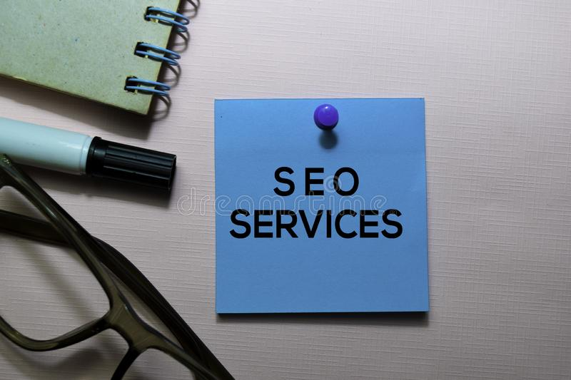 SEO Services text on sticky notes isolated on office desk royalty free stock image