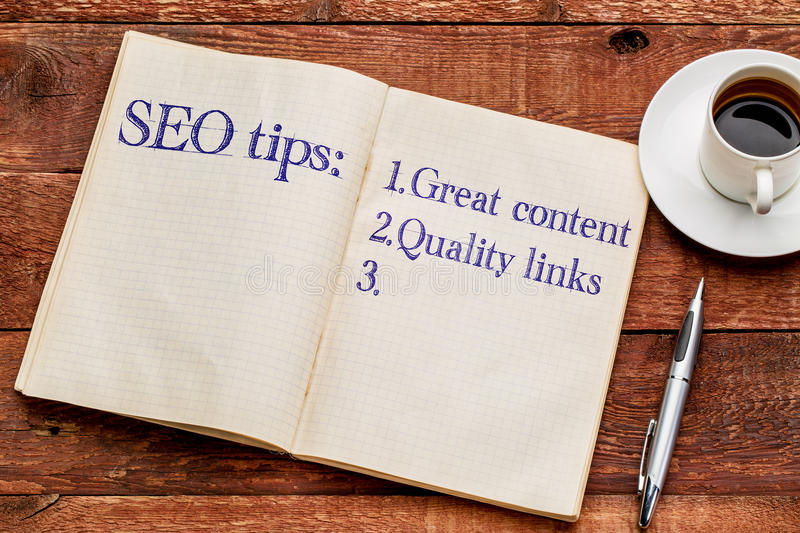 SEO tips in a notebook with coffee stock images