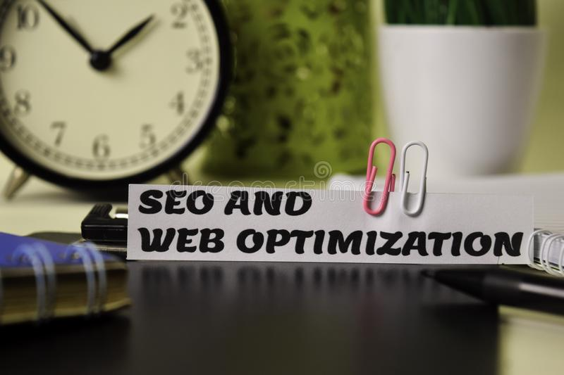 Seo and Web Optimization on the paper isolated on it desk. Business and inspiration concept stock photos