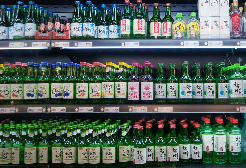SEOUL, KOREA - MARCH 13, 2017: Soju bottles of various flavors displayed in the supermarket in South Korea royalty free stock image