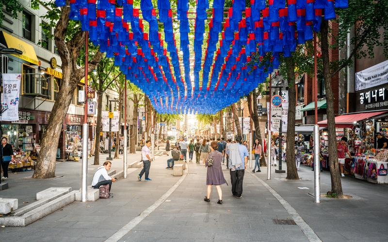 Streetview of Insadong pedestrian street with people and dramatic sunset light in Insa-dong Seoul South Korea stock photos