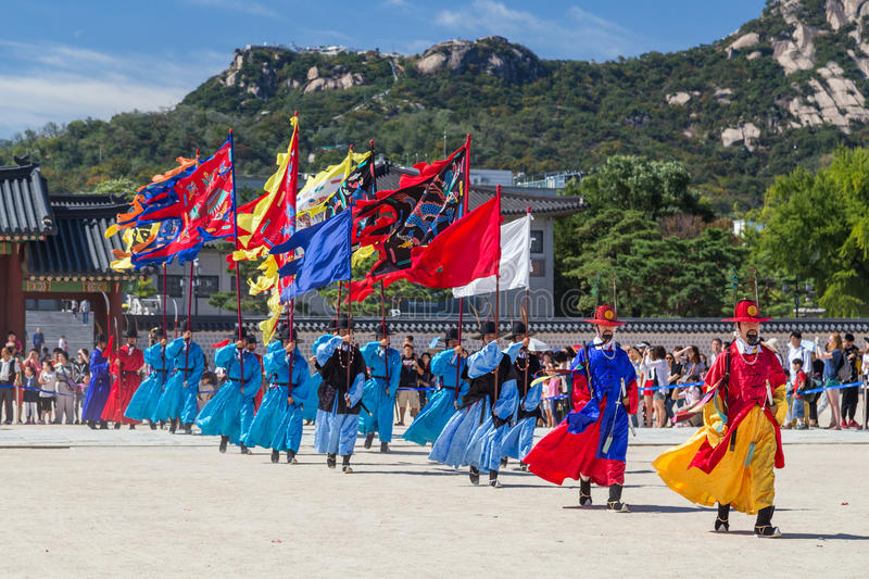 Seoul, South Korea - circa September 2015: Palace guards marching in traditional Korean dresses in Gyeongbokgung Palace, Seoul, K. Orea royalty free stock photos