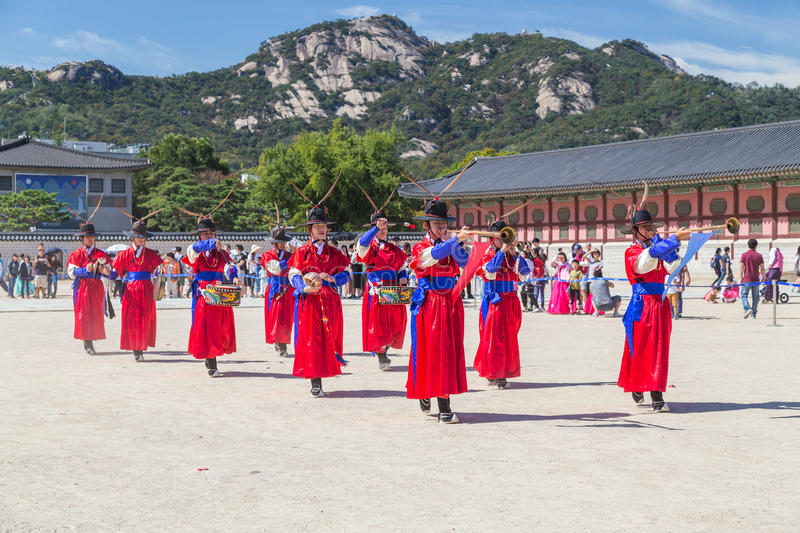 Seoul, South Korea - circa September 2015: Palace guards marching in traditional Korean dresses in Gyeongbokgung Palace, Seoul, K. Orea stock photos