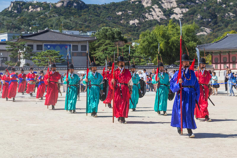 Seoul, South Korea - circa September 2015: Palace guards marching in traditional Korean dresses in Gyeongbokgung Palace, Seoul, K. Orea royalty free stock image