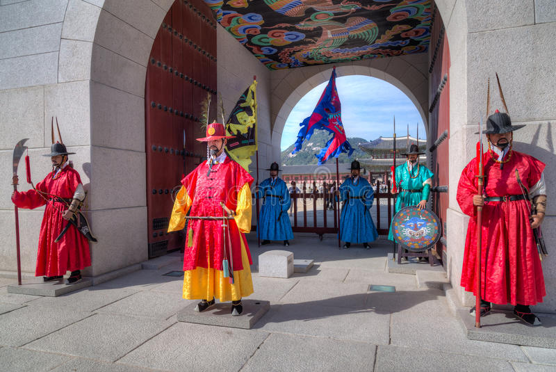 Seoul, South Korea - circa September 2015: Palace guards in traditional Korean dresses in Gyeongbokgung Palace, Seoul, Korea royalty free stock photography