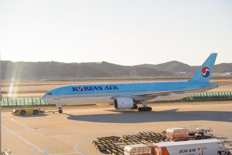 Seoul, South Korea - December 17, 2015 : The Korea air by Boeing 777-200 Reg. HL7575 was taxing to the terminal royalty free stock photo