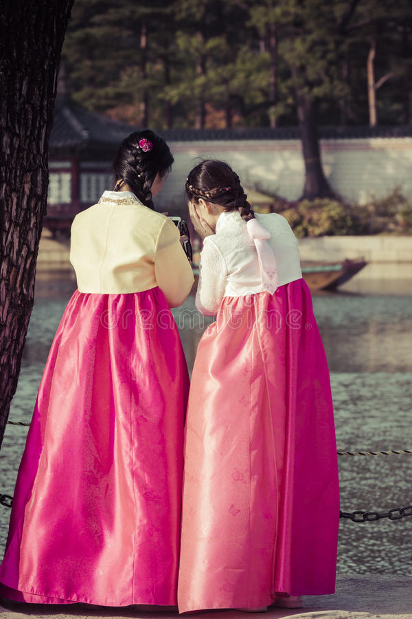 Seoul, South Korea - October 20, 2016: Young girls in traditional dresses at Gyeongbokgung Palace of Seoul, South Korea. royalty free stock photography