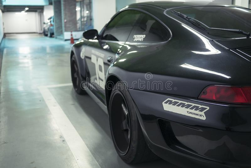 Seoul, South Korea - 03.11.18: tuning black Porsche 911 rear view. royalty free stock images