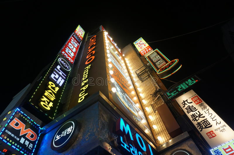 Seoul street signs. Bright, vibrant street signs lighting up the streets of Gangnam, Seoul, in Korea stock image