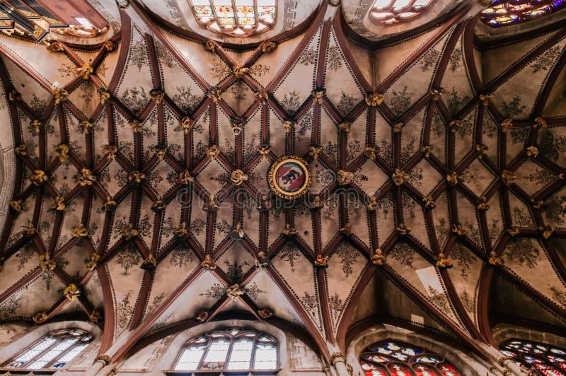 Extraordinary ceiling of Evangelical Church, Munster Bern, Switz. SEP 27, 2013 Bern, Switzerland - Extraordinary beautiful stone ceiling with city seals at stock photo