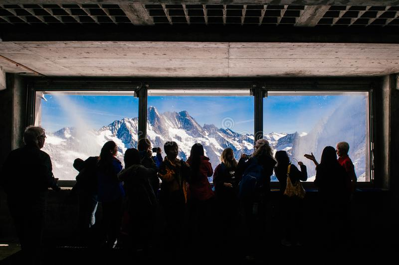 Panoramic view of Eiger and Monch peaks from Eiger tunnel, Switzerland royalty free stock images