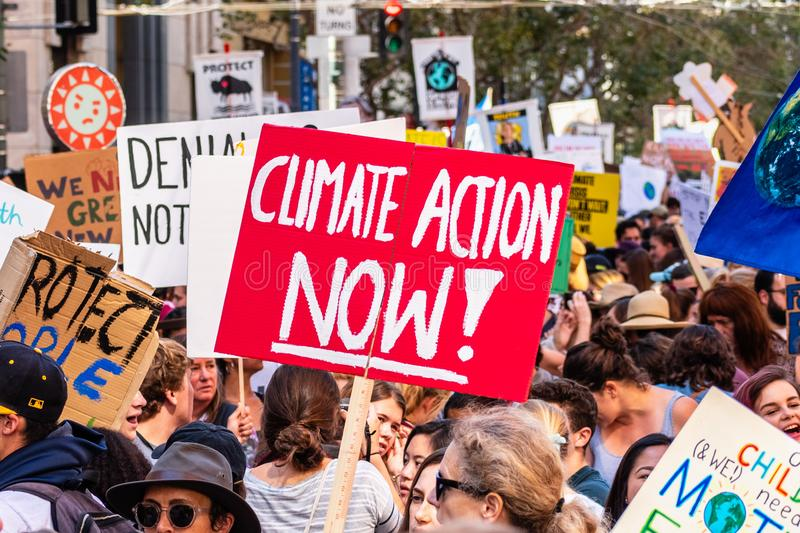Sep 20, 2019 San Francisco / CA / USA - Climate action now placard raised at the Global Climate Strike Rally and March in downtown. San Francisco stock photo