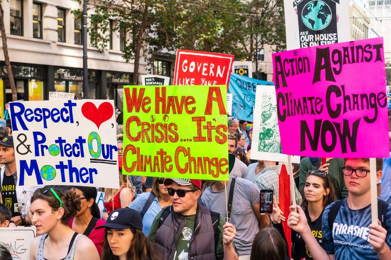 Sep 20, 2019 San Francisco / CA / USA - Protesters carrying placards and banners at the Climate Strike Rally and March in downtown royalty free stock image