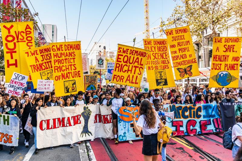 Sep 20, 2019 San Francisco / CA / USA - Protesters carrying placards and banners at the Climate Strike Rally and March in downtown. San Francisco royalty free stock photography