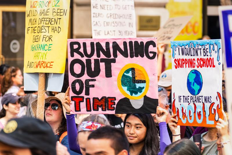 Sep 20, 2019 San Francisco / CA / USA - Running our of time and other placards with Climate change related messages raised at the royalty free stock photo