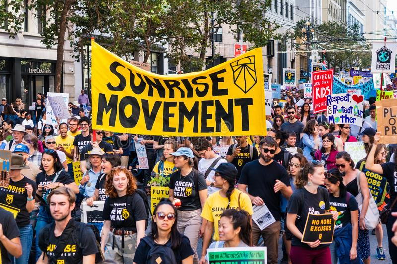 Sep 20, 2019 San Francisco / CA / USA - Sunrise Movement an American youth-led political movement members carrying placards and stock images