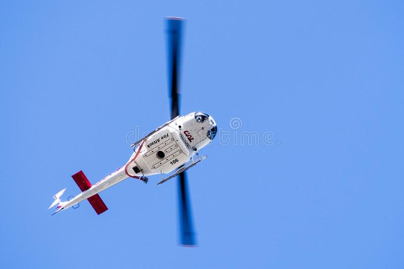 Sep 23, 2019 Santa Clara / CA / USA - Cal Fire California Department of Forestry and Fire Protection helicopter responding to an. Emergency call in South San royalty free stock photos