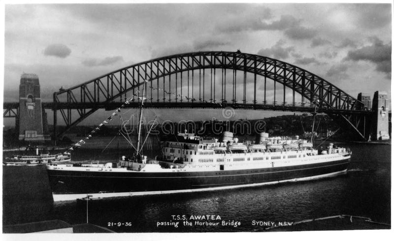 21 Sep 1936 - T.S.S. Awatea passing the Harbour Bridge, Sydney - real photo post card - Restored Version royalty free stock image