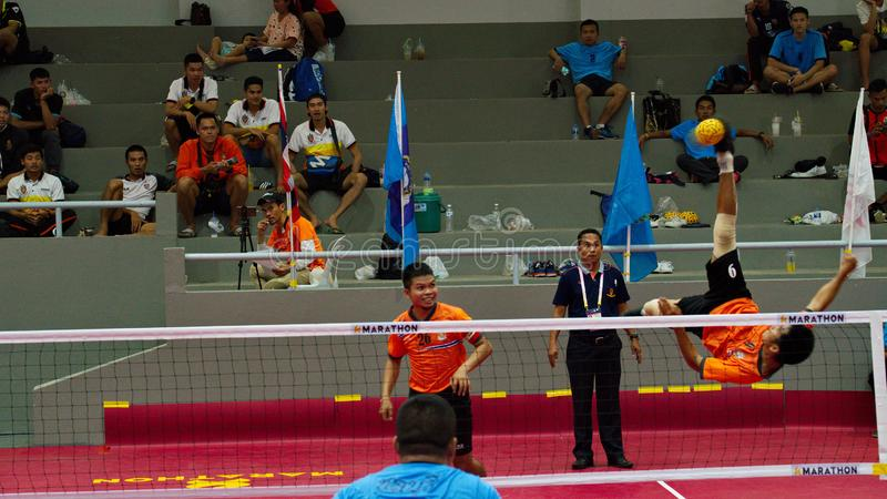 Sepak takraw two player team, player making a service at The 2018 Thailand National Games, Chiang Rai Games. Chiang Rai, Thailand - November 19, 2018 : Sepak royalty free stock photography