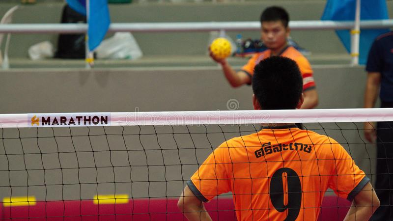 Sepak takraw two player team, player making a service at The 2018 Thailand National Games, Chiang Rai Games. Chiang Rai, Thailand - November 19, 2018 : Sepak stock photo