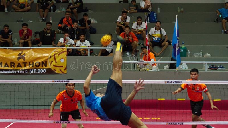 Sepak takraw two player team, player making a service at The 2018 Thailand National Games, Chiang Rai Games. Chiang Rai, Thailand - November 19, 2018 : Sepak royalty free stock photo