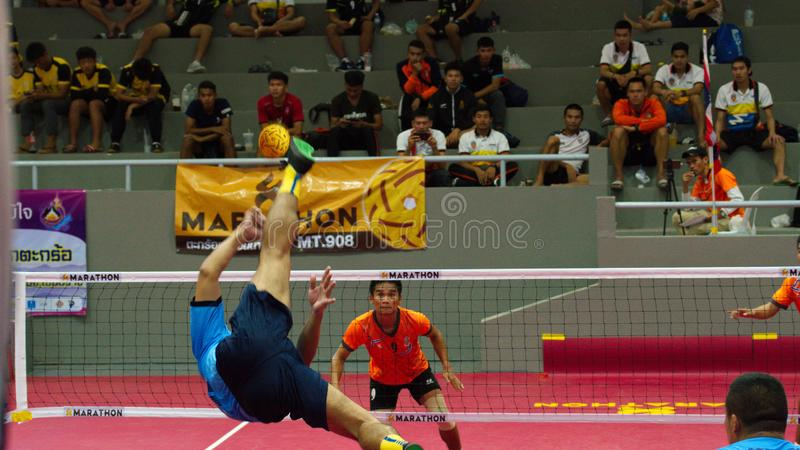 Sepak takraw two player team, player making a service at The 2018 Thailand National Games, Chiang Rai Games. Chiang Rai, Thailand - November 19, 2018 : Sepak royalty free stock image