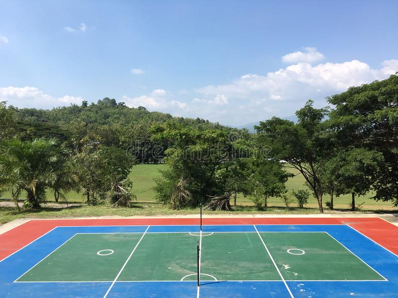 Sepaktakraw court with trees and blue sky background. royalty free stock photo
