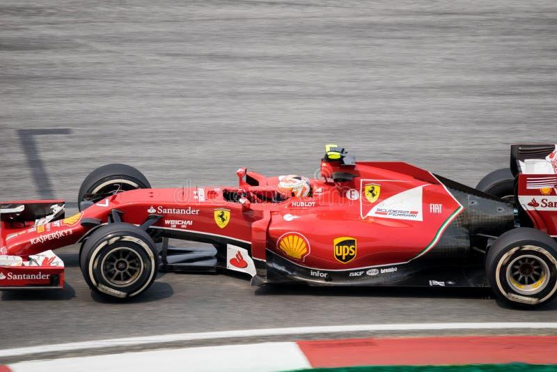 SEPANG - 28 DE MARZO: Kimi Räikkönen en la curva pasada fotografía de archivo libre de regalías