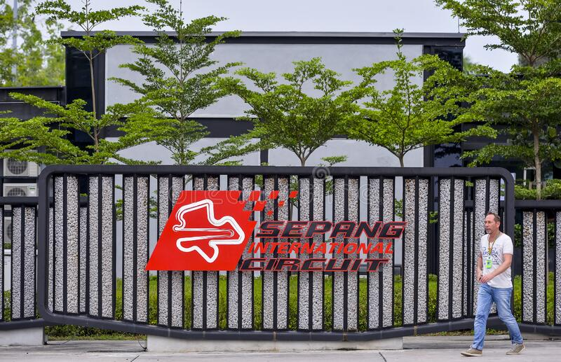 Sepang International Circuit SIC Malaysia. SEPANG, MALAYSIA - SEPTEMBER 29, 2017: Sepang International Circuit SIC Malaysia logo on signboard at paddock entrance stock image