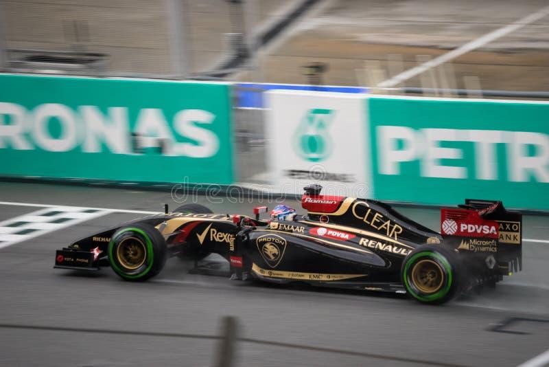 SEPANG - 29 MAART: Romain Grosjean Driving Rain stock foto's