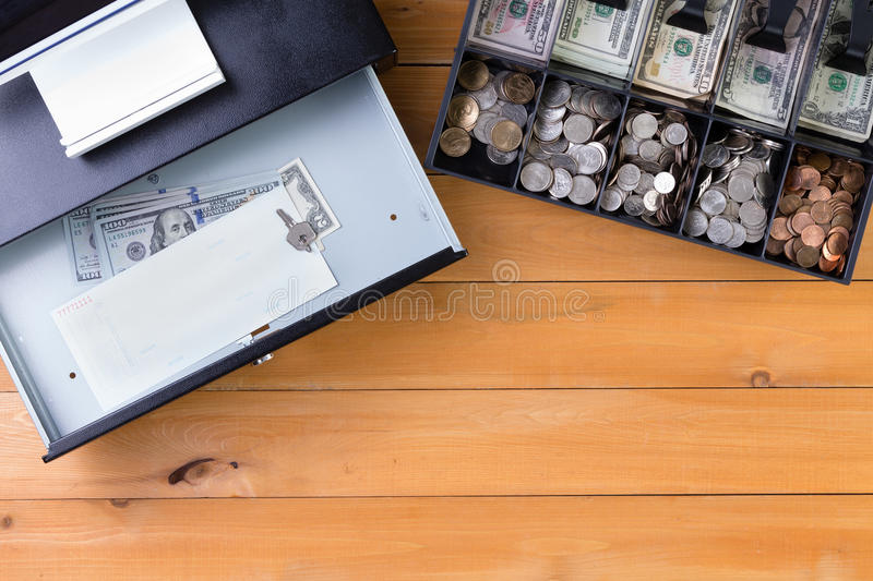Separate cash drawer beside register on table stock images