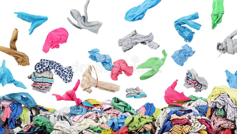Separate clothing falling at the big pile of clothes. On a white background royalty free stock images