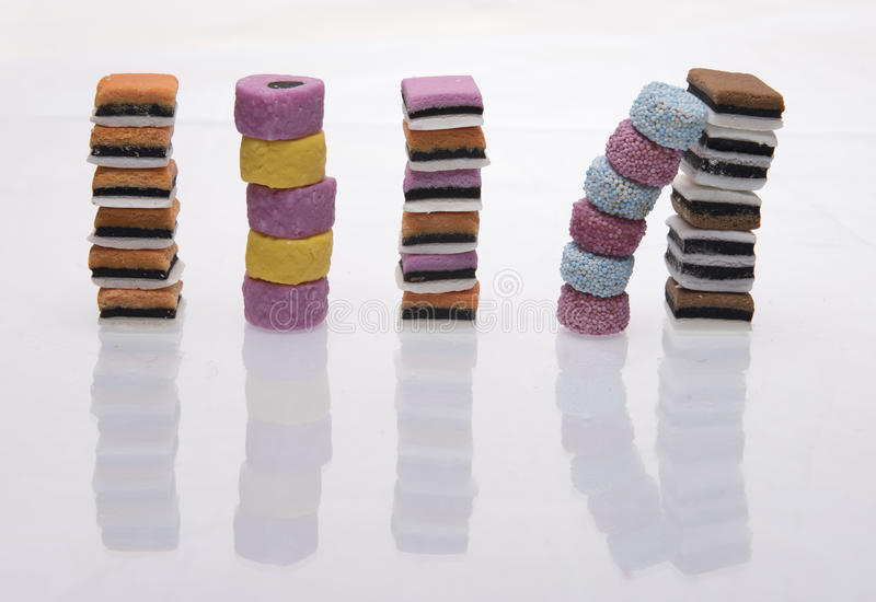 Separate stacks of licorice all-sorts. On a white background royalty free stock images