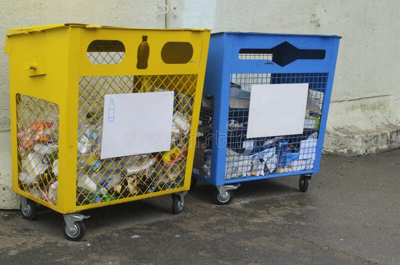 Separate waste collection. One container for collecting plastic, the other for waste paper.  stock photography
