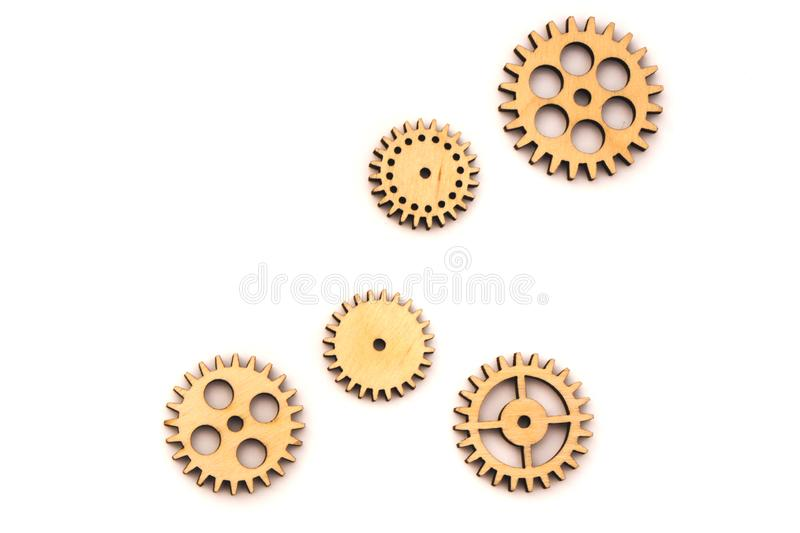 separated wooden gears of different sizes isolated on white background stock photos