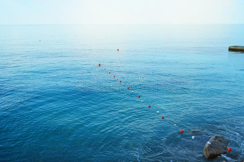 Separation buoys in the sea for safe swimming on the beach stock photos