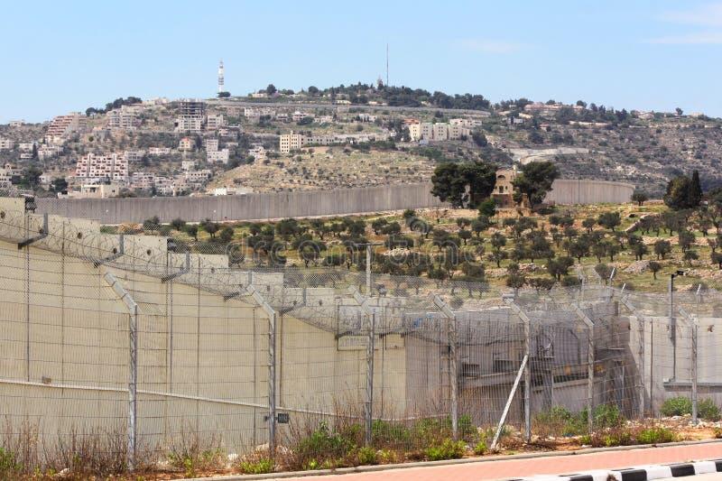 Separation Wall Shimmering in Heat, near Gilo 300 Checkpoint, Bethlehem, Israel. SEPARATION WALL NEAR BETHLEHEM, ISRAEL, 2 APRIL 2013. Editorial Photograph of royalty free stock photos