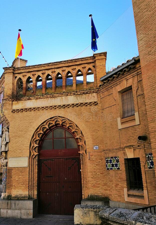 Sephardic Museum entrance with Spain and Europe flags hanging on the top in Toledo, Spain. A Sephardic Museum entrance with Spain and Europe flags hanging on the stock photography