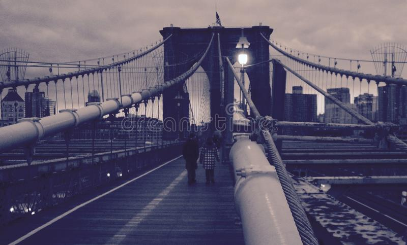 A sepia blast of the cables of the Brooklyn Bridge looking onto Manhattan - USA stock image