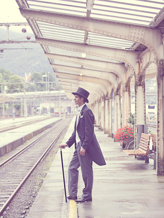 Sepia Effects Photo Of Man In Black Tuxedo Standing On Train Station During Daytime Free Public Domain Cc0 Image