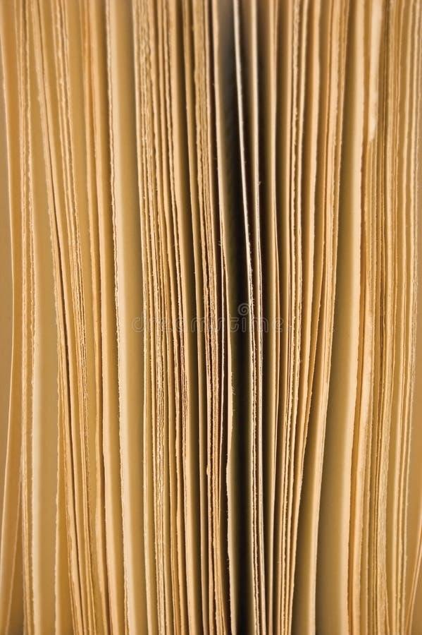 sepia för sidor för bakgrundsbokcloseup öppen litet royaltyfri bild