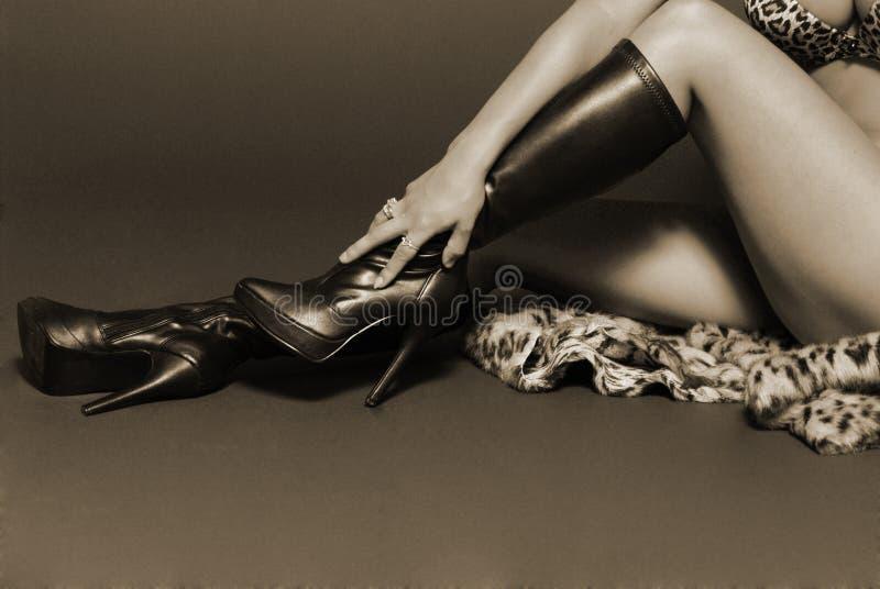 Sepia female legs royalty free stock photos