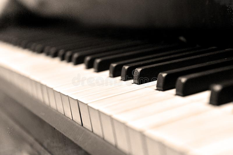 Sepia keyboard of the old piano royalty free stock image