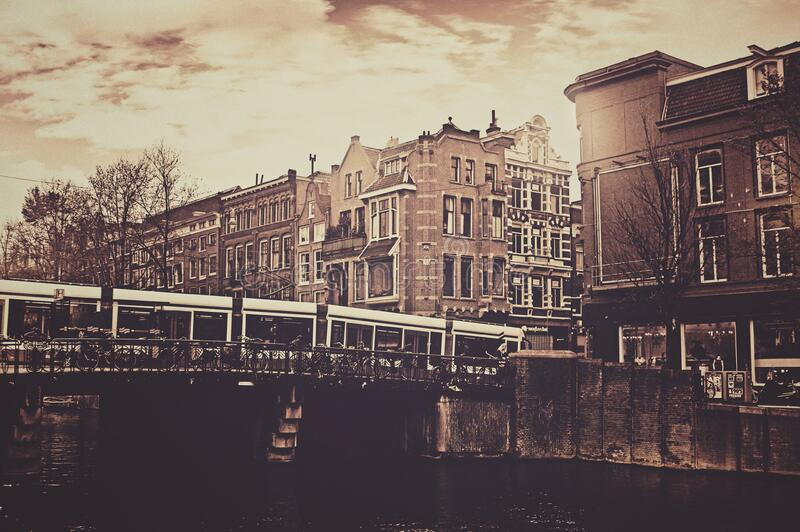 Sepia Photography of Bridge and Concrete House royalty free stock image