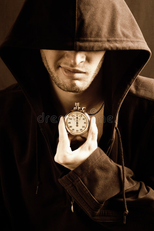 Sepia picture of a handsome guy with a stopwatch stock photos