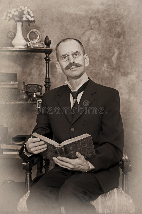Sepia portrait of man reading the book stock photo